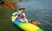 Mature Woman Enjoys Peaceful Paddling in her Kayak — Stock Photo