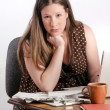 Confident Serious Looking Pregnant Woman with Stack of Unpaid Bills Sitting at Desk — Stock Photo