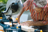 Man Sawing Wood with Sliding Compound Miter Saw Closeup — Stock Photo
