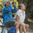 Senior Couple Hiking, Birdwatching and Camping — Stock Photo