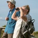 Senior Couple Hiking and Birdwatching with Binoculars — Stock Photo