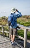 Man Birdwatching in Florida Wetlands — Stock Photo