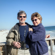 Happy Retired Couple on Fishing Pier at Sunny Beach — Stock Photo