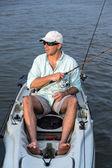 Man Fishing in Kayak — Stock Photo