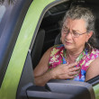 Overheated frustrated senior woman driver with sudden chest pain — Stock Photo #49083629