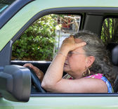 Frustrated senior woman driver — Stock Photo