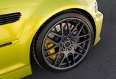 Black alloy wheel — Stock Photo