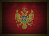Montenegro flag wall, abstract grunge background — Stock Photo