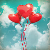 The blue cloudy sky with balloons, valentines background — Stock Photo