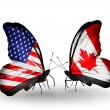 Two butterflies with flags on wings as symbol of relations USA and Canada — Stock Photo