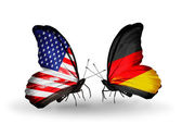 Two butterflies with flags on wings as symbol of relations USA and Germany — Stock Photo