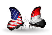 Two butterflies with flags on wings as symbol of relations USA and Yemen — Stock Photo
