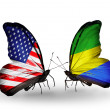 Two butterflies with flags on wings as symbol of relations USand Gabon — Stock Photo #29967935