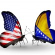 Stock Photo: Two butterflies with flags on wings as symbol of relations USand Bosniand Herzegovina