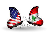 Two butterflies with flags on wings as symbol of relations USA and Lebanon — Stock Photo