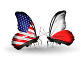 Two butterflies with flags on wings as symbol of relations USA and Poland — Stock Photo