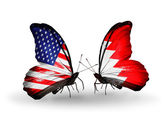 Two butterflies with flags on wings as symbol of relations USA and Bahrain — Stock Photo