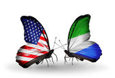Two butterflies with flags on wings as symbol of relations USA and Sierra Leone — Stock Photo
