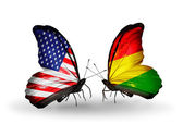 Two butterflies with flags on wings as symbol of relations USA and Bolivia — Stock Photo