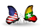 Two butterflies with flags on wings as symbol of relations USA and Myanmar — Stock Photo