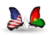 Due farfalle con bandiere sulle ali come simbolo delle relazioni usa e burkina faso — Foto Stock