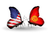 Two butterflies with flags on wings as symbol of relations USA and Kirghiz — Stock Photo