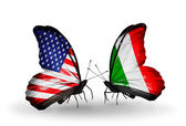 Two butterflies with flags on wings as symbol of relations USA and Italy — Stock Photo