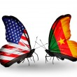 Stock Photo: Two butterflies with flags on wings as symbol of relations USand Cameroon