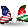 Stock Photo: Two butterflies with flags on wings as symbol of relations USand Abkhazia