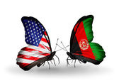 Two butterflies with flags on wings as symbol of relations USA and Afganistan — Stock Photo