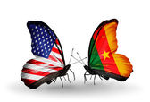 Two butterflies with flags on wings as symbol of relations USA and Cameroon — Stock Photo