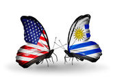 Two butterflies with flags on wings as symbol of relations USA and Uruguay — Stock Photo