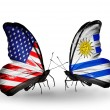 Two butterflies with flags on wings as symbol of relations USA and Uruguay — Stockfoto
