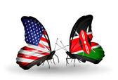 Dva motýli s příznaky na křídlech jako symbol vztahy usa a kenia — Stock fotografie
