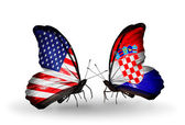 Two butterflies with flags on wings as symbol of relations USA and Croatia — Stock Photo
