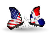 Two butterflies with flags on wings as symbol of relations USA and Dominicana — Stock Photo