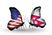 Två fjärilar med flaggor på vingarna som symbol för förbindelserna mellan usa och nepal — Stockfoto