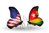Two butterflies with flags on wings as symbol of relations USA and Togo — Stock Photo
