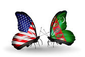 Two butterflies with flags on wings as symbol of relations USA and Turkmenistan — Stock Photo