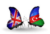 Two butterflies with flags on wings as symbol of relations UK and Azerbaijan — Stock Photo