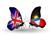 Two butterflies with flags on wings as symbol of relations UK and Antigua and Barbuda — Stock Photo