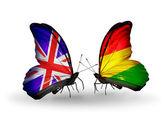 Dos mariposas con banderas en las alas como símbolo de las relaciones reino unido y bolivia — Foto de Stock