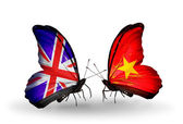 Two butterflies with flags on wings as symbol of relations UK and Vietnam — Stock Photo