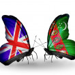Two butterflies with flags on wings as symbol of relations UK and Turkmenistan — Foto Stock