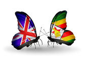 Two butterflies with flags on wings as symbol of relations UK and Zimbabwe — Stock Photo