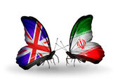 Two butterflies with flags on wings as symbol of relations UK and Iran — Foto de Stock