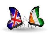 Two butterflies with flags on wings as symbol of relations UK and Cote Divoire — Stock Photo