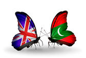 Two butterflies with flags on wings as symbol of relations UK and Maldives — Stock Photo