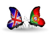 Two butterflies with flags on wings as symbol of relations UK and Portugal — Stock Photo