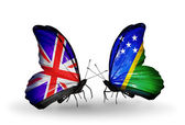 Two butterflies with flags on wings as symbol of relations UK and Solomon Islands — Stock Photo